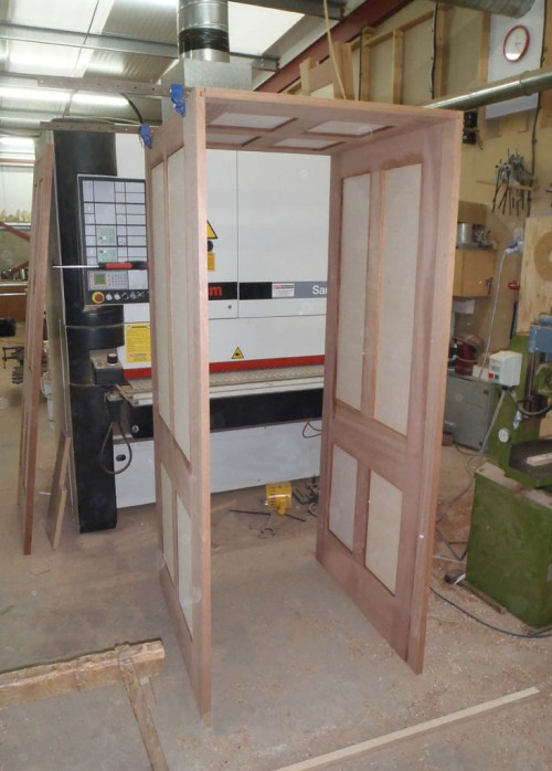Walk-through bookcase frame construction