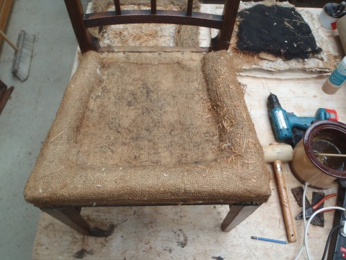 Dining chair requiring upholstery