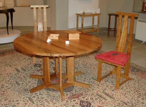 Round ripple oak table and chairs